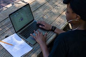 Rudo Ndamba conducts research outside.