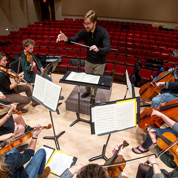 Paul Luongo conducting students