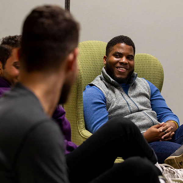 Jordan Crawford '21 listens to discussion during a meeting of Whitman's Men of Color Association.